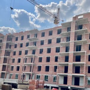 Капітальне будівництво зовнішніх стін 8-го фактичного поверху
